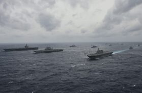 1200px-Ships_from_the_Indian_Navy,_Japan_Maritime_Self-Defense_Force_and_the_U.S._Navy_sail_in_formation_in_the_Bay_of_Bengal_during_exercise_Malabar_201